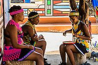 Women in traditional costume, Lesedi Cultural Village, Broederstroom (near Johannesburg), South Africa. The cultural village includes five traditional homesteads, each inhabited by Zulu, Xhosa, Pedi, Basotho and Ndebele tribes who live according to tribal folklore and traditions of their ancestors.