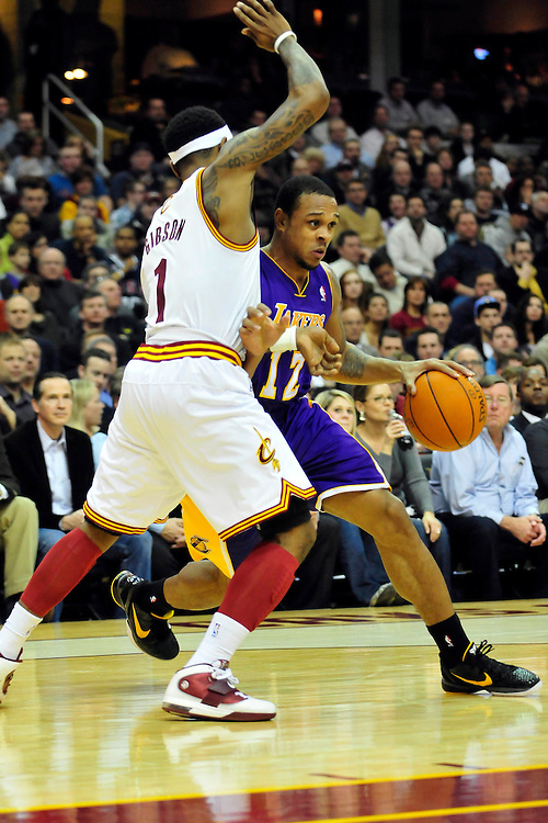 Feb. 16, 2011; Cleveland, OH, USA; Cleveland Cavaliers point guard Daniel Gibson (1) puts pressure on Los Angeles Lakers point guard Shannon Brown (12) during the third quarter at Quicken Loans Arena. The Cavaliers beat the Lakers 104-99. Mandatory Credit: Jason Miller-US PRESSWIRE