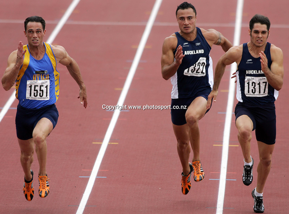(L-R) Chris Donaldson (Otago), David Falealili (Auckland) and James Dolphin (Auckalnd) compete in the Men's 100m final at the 2007 Union Athletics New Zealand Track &amp; Field Championships at TET Stadium, Inglewood, New Zealand on Saturday 3 March 2007. Photo: Hannah Johnston/PHOTOSPORT<br /> <br /> <br /> <br /> 030307