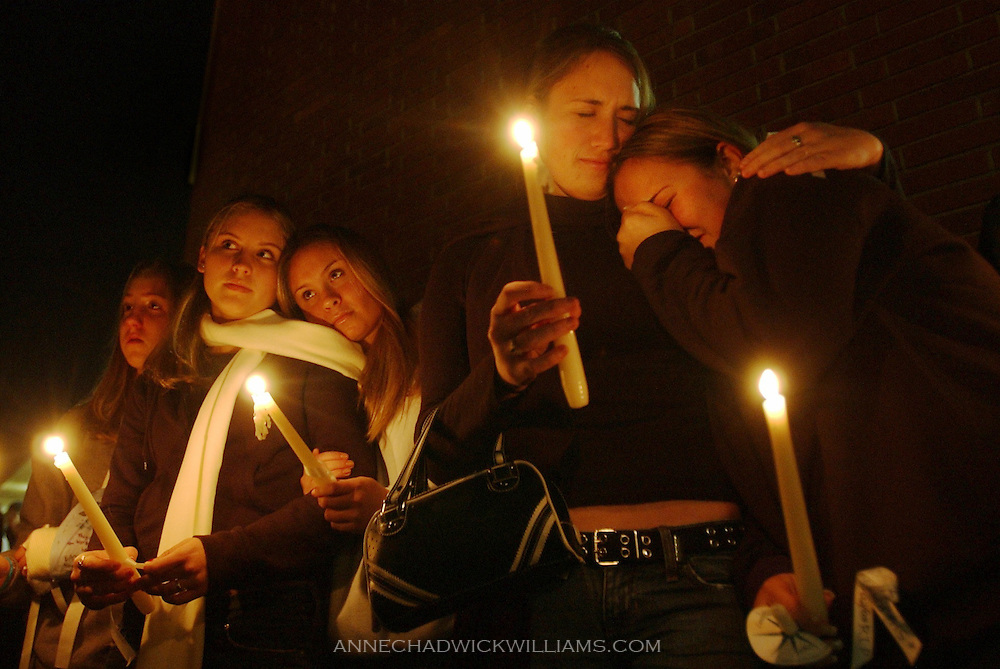 Friends of Sharmelia Jeffries, 17, who was killed by a drunk driver, gather at Christian Brothers High School for a candelight vigil in her honor. From r-l: Shannon Charles, Laura McGee, Kelly Ahrendt, Tara McGee, Stephanie Gabrielli, freshman, on December 3, 2003.