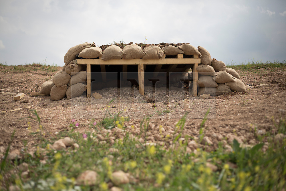 © Licensed to London News Pictures. 30/03/2015. Erbil, Iraq. A German coalition forces constructed bunker, used to teach Kurdish peshmerga on defensive tactics, is seen at a military training area near Erbil, Iraq.<br /> <br /> The training is part of a four week long package, the first to be held with a complete peshmerga battalion, run by coalition forces mobile training teams (MTT) in Kurdistan with the aim to make the peshmerga more efficient in combatting the Islamic State. Photo credit: Matt Cetti-Roberts/LNP