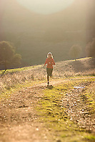 Heather Harrison trail running in the Sierra Foothills near Auburn, CA.