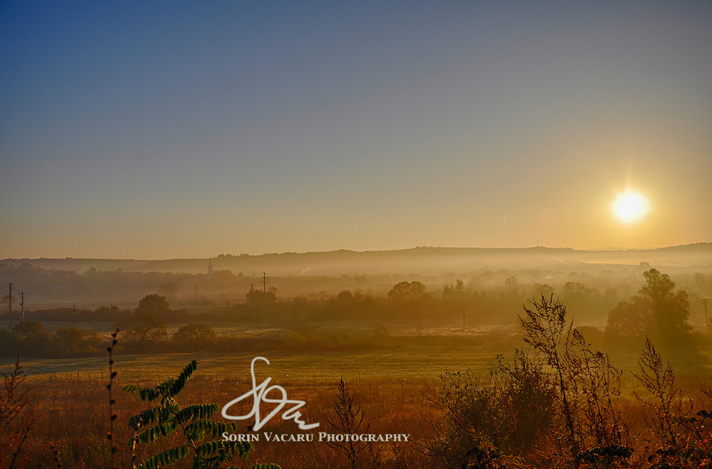 Sun rising over the Romanian countryside on an early October day.