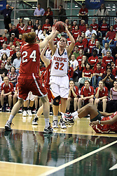 20 March 2010: Erika Bruinsma gets clear for a shot before Zoe Unruh can get to her for the block. The Flying Dutch of Hope College fall to the Bears of Washington University 65-59 in the Championship Game of the Division 3 Women's NCAA Basketball Championship the at the Shirk Center at Illinois Wesleyan in Bloomington Illinois.