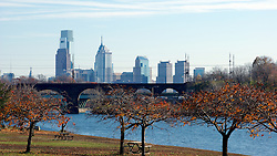 Fall scene along the Schyllkill River with Philly's skyline in the background.