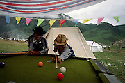 Boys playing pool at a Tibetan horse festival 2006