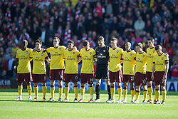 WEST BROMWICH, ENGLAND - Saturday, March 19, 2011: Arsenal's players stand for a minute's silence to remember those who lost their lives in the earthquake and tsunami in Japan before the Premiership match against West Bromwich Albion at the Hawthorns. (Photo by David Rawcliffe/Propaganda)