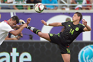 Mexico forward Javier Hernandez (14) kicks Costa Rico defender Giancarlo Gonzalez, left, while going for the ball during the second half of a friendly soccer match in Orlando, Fla., Saturday, June 27, 2015. The teams tied 2-2. (AP Photo/Phelan M. Ebenhack)