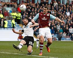Derby County's Jake Buxton clears under pressure from Burnley's Sam Vokes - Photo mandatory by-line: Matt Bunn/JMP - Tel: Mobile: 07966 386802 22/02/2014 - SPORT - FOOTBALL - Turf Moor Stadium- Burnley - Burnley  v Derby County- Sky Bet Championship