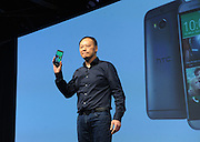 Peter Chou, CEO, HTC Corporation, unveils the HTC One (M8), the company's new flagship smartphone, Tuesday, March 25, 2014, in New York. (Photo by Diane Bondareff/Invision for HTC/AP Images)