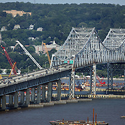 Construction work underway on a new NY Bridge to replace the deteriorating structure of the Tappan Zee Bridge which crosses the Hudson River in the state of New York. The bridge connects South Nyack in Rockland County with Tarrytown in Westchester County in the Lower Hudson Valley. The new bridge will be designed and constructed to last 100 years without major structural maintenance and is due to open in 2016. Tappan Zee Bridge, New York State, USA. 12th July 2014. Photo Tim Clayton