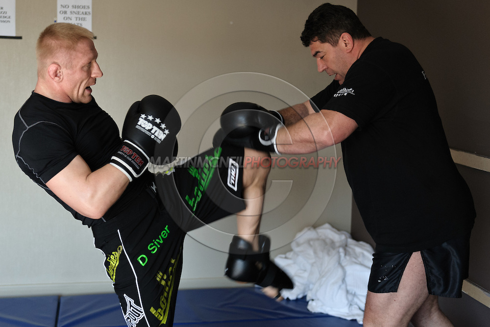 SYDNEY, AUSTRALIA, FEBRUARY 24, 2011: UFC lightweight division fighter Dennis Siver (left) trains wtih coach Nico Sulenta ahead of his fight with George Sotiropoulos at UFC 127.