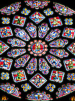Our Lady of Chartres Cathedral, Chartres, France. North Transept rose window. Dedicated to the Virgin, the central oculus shows the Virgin and Child and is surrounded by 12 small petal-shaped windows, 4 with doves, the rest with angels carrying candlesticks. Beyond this is a ring of 12 diamond-shaped openings containing the Old Testament Kings of Judah, another ring of smaller lozenges containing the arms of France and Castille, and finally a ring of semi-circles containing Old Testament Prophets holding scrolls.