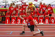 Track volunteers and staff pose for photos after the Muller Anniversary Games 2019 at the London Stadium, London, England on 20 July 2019.