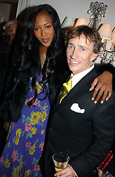 JASPER CONRAN and model NAOMI CAMPBELL at a party to celebrate the opening of Jasper Conran's new shop and HQ at 36 Sackville Street, London W1 on 15th February 2005.<br />