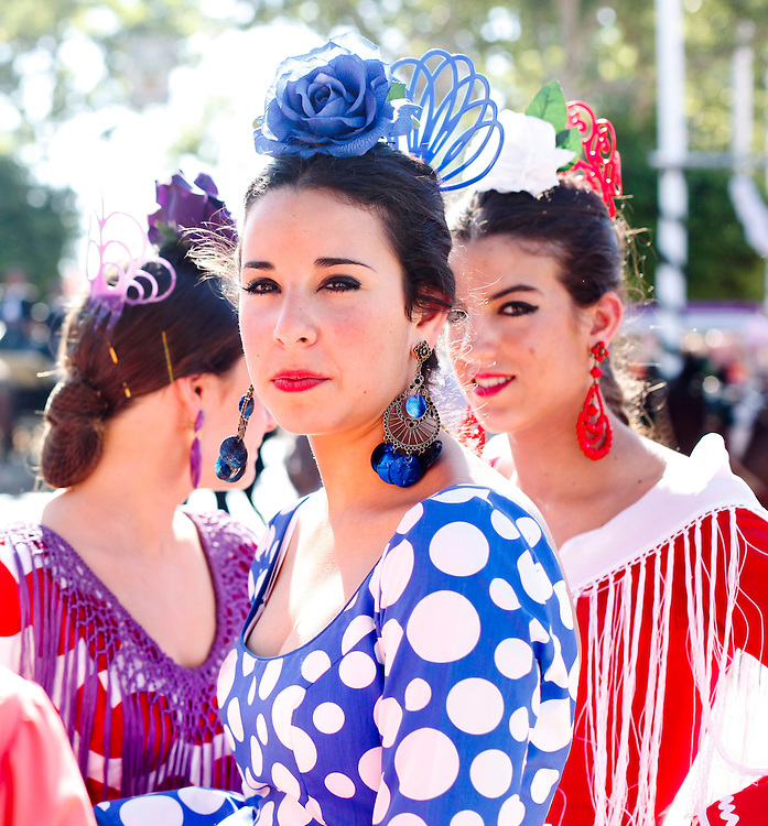 "Abril, 20, 2010. Lifestyle/Spain. Seville April Fair. A crowd of people attend today the first real day of the ""feria de Abril"" of Seville. Many women dresses with the traditional costume of ""Flamenca"" and the people walk,  dance ""sevillanas"" (typical sevilian dance) and drink ""rebujito"" (typical drink of the ""Feria de Abril"" made by the youngdry wine ""Manzanilla""  and carbonated drink...Una multitud de personas asisten hoy al primer día real de la feria de Abril de Sevilla. Muchas mujeres se visten con el traje tradicional de ""flamenca"" y pasean por el recinto ferial mientras bailan, beben ""rebujito"" (bebida típica de la feri de Abril hecha de ""Manzanilla"" y bebida gaseosa y montan a caballo o en carruaje."