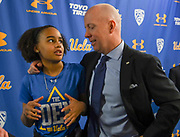 Mick Cronin (right) embraces daughter Samantha Cronin after being introduced as the UCLA Bruins new head basketball coach at a news conference on the campus in Los Angeles Wednesday, April 10, 2019. Cronin was hired as UCLA's basketball coach Tuesday, ending a bumpy, months-long search to find a replacement for the fired Steve Alford. The university said Cronin agreed to a $24 million, six-year deal. (Dylan Stewart/Image of Sport)