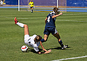 Robert Morris University's forward Antonia Grese (Jr.) and NAU's defender Danny Muniz (Jr.) clash together  during the first half of the RMU vs. NAU soccer game on Sunday, Sept. 20, 2015. Grese would fall during the battle and Muniz would help get the ball towards the RMU's goal. (Photo by David Carballido-Jeans)