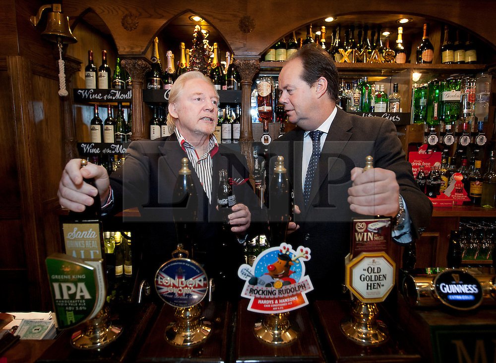 © Licensed to London News Pictures. 06/12/2012. London, UK. Road Safety Minister, Stephen Hammond (R), chats with pub land lord Kieron Murphy (L) at the launch of the 2012 Designated Drivers Campaign in the Mason's Arms Pub in London today (06/12/12). The campaign, aimed at providing free non-alcoholic drinks for designated drivers, is sponsored by soft drinks company Coca Cola and runs from 6-31 December 2012.    Photo credit: Matt Cetti-Roberts/LNP