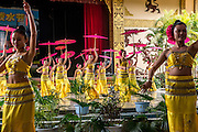Dancers perform for tourists at the Olive Dam Dai cultural village in Xishuangbanna, China. The Dai are an ethnic minority living in western China as well as northern Laos, Thailand, and Vietnam.
