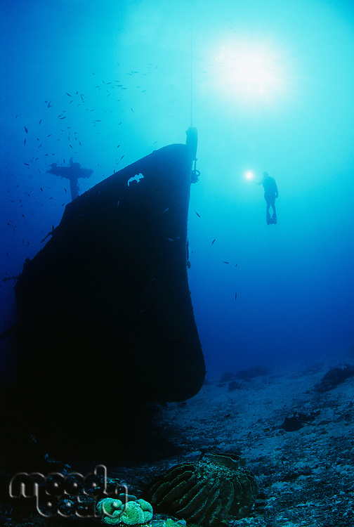 Diver exploring bow of sunken fishing trawler