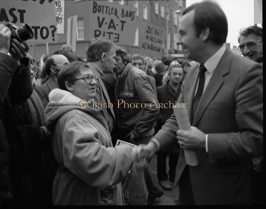 "Irish Theatre Industry Protest at Leinster House.1983.07.12.1983.12.07.1983.7th December 1983...With the imposition of a 23% V.A.T.rate on theatre tickets, the theatre industry was feeling the strain. Maureen potter and Brendan Grace aka ""Bottler"" led the protest to the gates of Leinster House Dublin..Photo taken as Maureen politely confronts Fianna Fail T.D.Dr Michael Woods over the VAT rate."