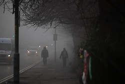 © Licensed to London News Pictures . 23/01/2019. Manchester , UK . Bury New Road in Prestwich is shrouded in fog . Clear skies and snow shrouds the hills in the North West as fog descends over Manchester City Centre . Photo credit : Joel Goodman/LNP