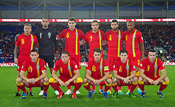CARDIFF, WALES - Tuesday, September 10, 2013: Wales' players line-up for a team group photograph before the 2014 FIFA World Cup Brazil Qualifying Group A match at the Cardiff CIty Stadium. Back row L-R: Craig Bellamy, goalkeeper Boaz Myhill, Sam Vokes, Andy King, Joe Ledley, Daniel Gabbidon. Front row L-R: Andrew Crofts, Chris Gunter, captain Aaron Ramsey, Adam Matthews. (Pic by David Rawcliffe/Propaganda)