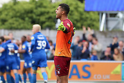 Rochdale goalkeeper Robert Sanchez (25) shouting with arms open after AFC Wimbledon attacker Marcus Forss (15) scores a goal during the EFL Sky Bet League 1 match between AFC Wimbledon and Rochdale at the Cherry Red Records Stadium, Kingston, England on 5 October 2019.