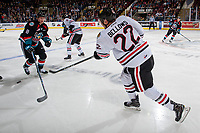 KELOWNA, BC - OCTOBER 20:  Kieffer Bellows #22 of the Portland Winterhawks shoots the puck past Jack Cowell #8 of the Kelowna Rockets at Prospera Place on October 20, 2017 in Kelowna, Canada. (Photo by Marissa Baecker/Getty Images)