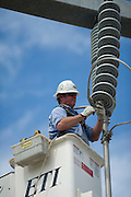Western Farmers Electric Coop linemen working to upgrade a substation south of Norman from 69,000 volts to 133,000 volts.