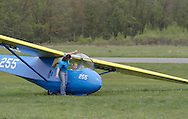 Wurtsboro, NY - An airport employee talks to a young girl in Schweizer SGS 2-33A glider before the girl takes a flight at the grand reopening of Wurtsboro Airport on May 11, 2008.