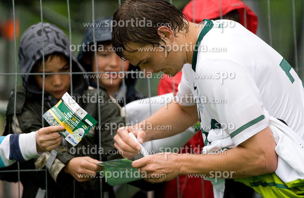 Nejc Pecnik of Slovenia with fans after the football match between National team of Slovenia and FC Sud Tirol, Bolzano  on May 29, 2010, at Sports park Riscone, in Brunico / Bruneck, Italy. Slovenia won 3-0. (Photo by Vid Ponikvar / Sportida)