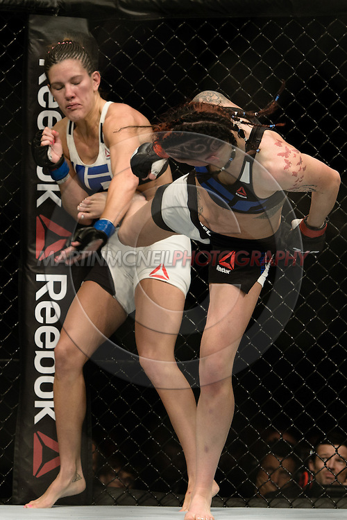 "GLASGOW, SCOTLAND, JULY 18, 2015: Joanne Calderwood (black/blue top) defeats Cortney Casey by unanimous decision during ""UFC Fight Night 72: Bisping vs. Leites"" inside the SSE Hydro Arena in Glasgow, Scotland (Martin McNeil for ESPN)"