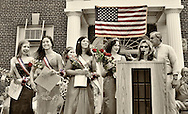 Winner of Miss Wantagh Pageant, Kara Arena, wearing tiara, and, to her left, 1st Runner Up, Shannon Dempsey, 2nd and 3rd runners-up, and  officials, at July 4th celebration in front of Wantagh High School, New York, 2011