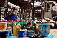 Ghana, Adaklu, Titikope, 2007. Bags of palm oil for cooking at home sit in a market vendor's stall. Village economies manage with small scale transactions..