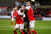 Wimbledon forward Kwesi Appiah (9) looks to meet the ball sandwiched between Fleetwood Town midfielder Ross Wallace (23)  and Fleetwood Town defender Ashley Eastham (5)  during the The FA Cup 3rd round match between Fleetwood Town and AFC Wimbledon at the Highbury Stadium, Fleetwood, England on 5 January 2019.