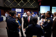 Congressional candidate from the 51st district Nick Popaditch talks with officers from the San Diego Police Department on primary election night as results are announced at Golden Hall in downtown San Diego, CA, June 8, 2010. Popaditch won the Republican nomination unopposed.