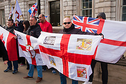 "London, February 8th 2015. Muslims demonstrate outside Downing Street  ""to denounce the uncivilised expressionists reprinting of the cartoon image of the Holy Prophet Muhammad"". PICTURED: A handful of counter-protesters from the English Defence league gather opposite the main site of the protest on Richmond Terrace."