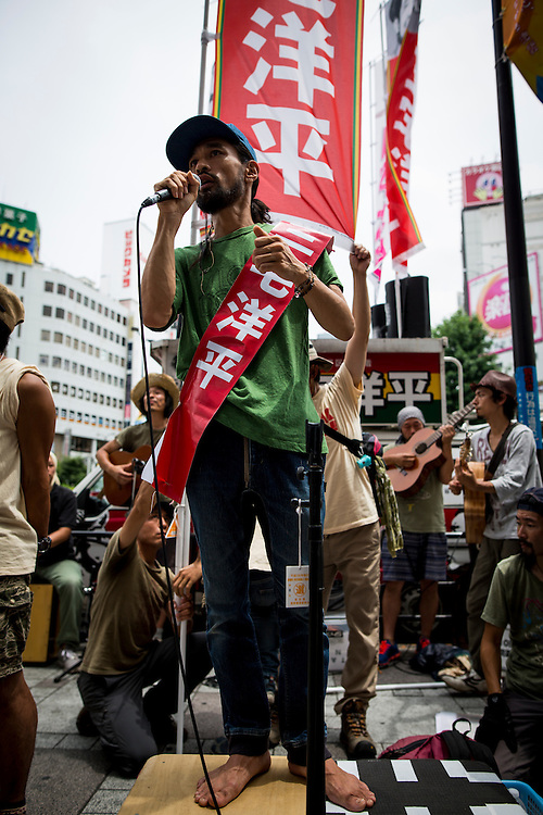 TOKYO, JAPAN - JULY 8 :  Yohei Miyake, Japanese musician and independent candidate for July's House of Councillors elections delivers his campaign speech during the Upper House election campaign outside of Ikebukuro Station, Tokyo, Japan, on July 8, 2016. The July 10, 2016 Upper house election is the first nation-wide election in Japan after government law changes its voting age from 20 years old to 18 years old. (Photo by Richard Atrero de Guzman/NUR Photo)