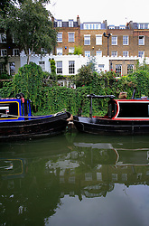 UK ENGLAND LONDON 12AUG07 - Canal boats lie moored in the Regency Canal in Islington, viewed from the bow of a canal boat...jre/Photo by Jiri Rezac..© Jiri Rezac 2007..Contact: +44 (0) 7050 110 417.Mobile:  +44 (0) 7801 337 683.Office:  +44 (0) 20 8968 9635..Email:   jiri@jirirezac.com.Web:    www.jirirezac.com..© All images Jiri Rezac 2007 - All rights reserved.