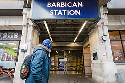 © Licensed to London News Pictures. 19/03/2020. London, UK. A man walks past Barbican tube station near St Bartholomew's Hospital in London which is seen closed this morning. Transport for London (TfL) are closing a number of underground stations from today, as partial closure of the tube and rail network begins in response to the growing coronavirus outbreak in the captial. Photo credit: Vickie Flores/LNP