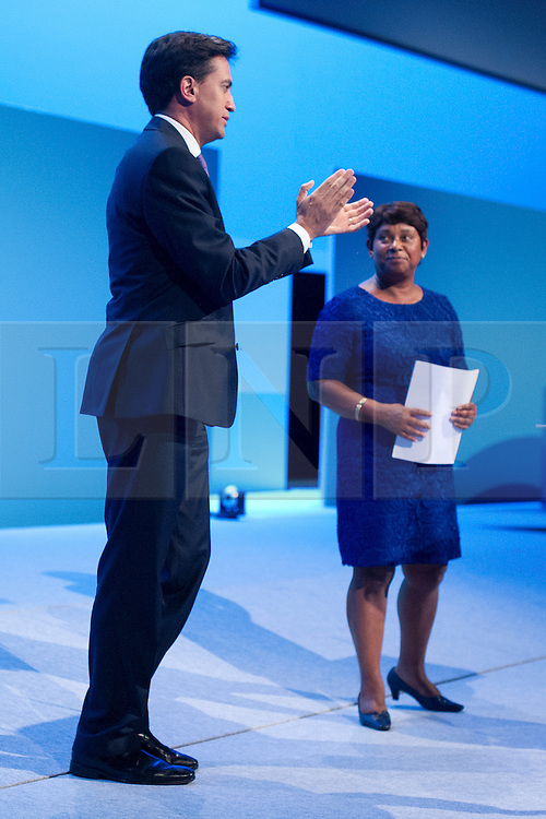 © London News Pictures. 25/09/2013 . Brighton, UK. Labour leader ED MILIBAND (left) greets DOREEN LAWRENCE (right)  on to the stage ahead of her speech on the last day of the  2013 Labour Party Conference at The Brighton Centre. Photo credit : Ben Cawthra/LNP