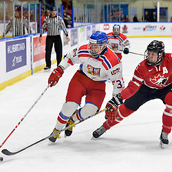 WHITBY, - Dec 16, 2015 -  Game #8 - Czech Republic vs. Canada East at the 2015 World Junior A Challenge at the Iroquois Park Recreation Complex, ON.  Jakub Sirota #3 of Team Czech Republic keeps the puck from Adam Smith #5 of Team Canada East during the first period.<br /> (Photo: Shawn Muir / OJHL Images)