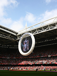 CARDIFF, WALES - SATURDAY, MAY 13th, 2006: Liverpool's fans watch as a giant FA Cup image is suspended in the air before the 125th FA Cup Final against West Ham United at the Millennium Stadium.