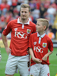 Mascot with Bristol City's Wade Elliott - Photo mandatory by-line: Dougie Allward/JMP - Mobile: 07966 386802 - 27/09/2014 - SPORT - Football - Bristol - Ashton Gate - Bristol City v MK Dons - Sky Bet League One