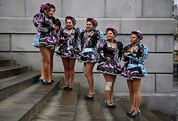 © Licensed to London News Pictures. 30/12/2016. London, UK. Bolivian dance group Caporales San Simon Londres wait to take part in a warmup event for New Years celebrations, at Trafalgar Square in London. Security will be increased across most UK New Year celebrations this year following the Berlin Christmas market terrorism attack.  Photo credit: Ben Cawthra/LNP