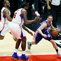 11 March 2017: Philadelphia 76ers guard TJ McConnell (1) drives past LA Clippers guard Chris Paul (3) and LA Clippers center DeAndre Jordan (6) during the LA Clippers 112-100 victory over the Philadelphia Sixers, at the Staples Center, Los Angeles, California, USA.