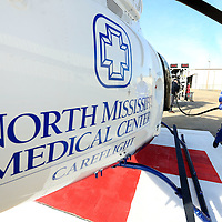 Adam Robison | BUY AT PHOTOS.DJOURNAL.COM<br /> Adam Palmer, pilot for North Mississippi Medical Center Careflight, walks up to the new state-of-the art Bell 407 GX to fuel it before taking flight Thursday afternoon. This new helicopter becomes the third to be assigned in Tupelo.