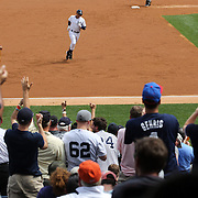 Alex Rodriguez rounds the bases to the cheers of the crowd after hitting a home run off Detroit Tigers pitcher Justin Verlander in front of a packed crowd at Yankee Stadium during the New York Yankees V Detroit Tigers MLB Regular season baseball game at Yankee Stadium, The Bronx, New York. 11th August 2013. Photo Tim Clayton